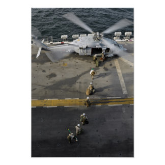 Marines prepare to board an MH-60S Poster