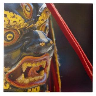 Mask dance performance at Tshechu Festival Tile