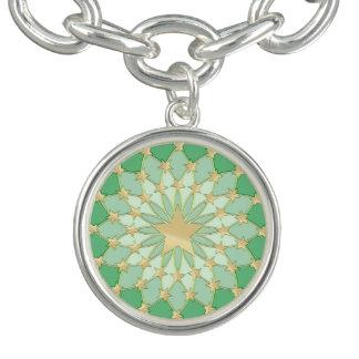 Matrix golden stars expanding circles pastel green charm bracelet