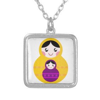 Matroshka yellow purple on white silver plated necklace