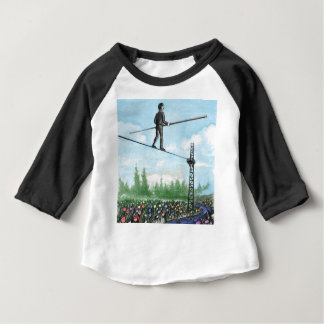 Mature Man Walking a Tightrope above Flowers Baby T-Shirt