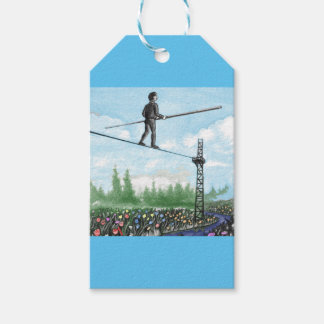 Mature Man Walking a Tightrope above Flowers Gift Tags
