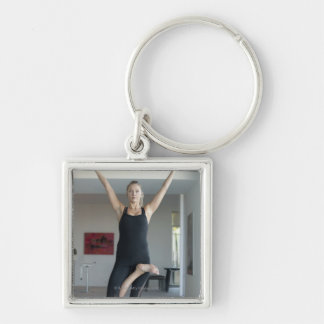 Mature woman exercising 2 Silver-Colored square keychain