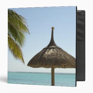 Mauritius. Idyllic beach scene with umbrella Binders
