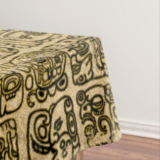 Mayan and aztec glyphs gold on vintage texture tablecloth