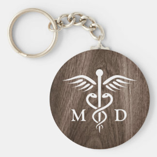 MD medical doctor with caduceus on wood background Basic Round Button Keychain