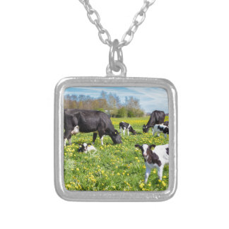 Meadow full of dandelions with grazing cows silver plated necklace