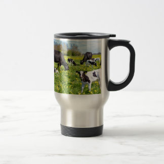 Meadow full of dandelions with grazing cows travel mug