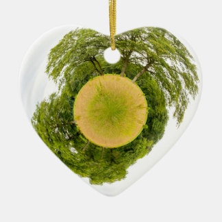 Meadow with trees like little planet ceramic heart ornament