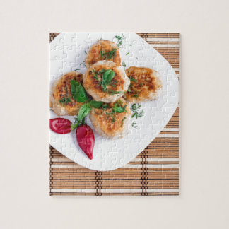 Meatballs of minced chicken with red pepper puzzles
