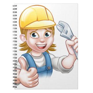 Mechanic or Plumber Woman Holding Spanner Notebooks