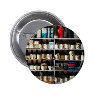 Mechanic Themed, Greasy Oil Containers On A Shelf 2 Inch Round Button