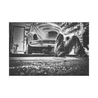 Mechanic working on his Beetle Canvas Print