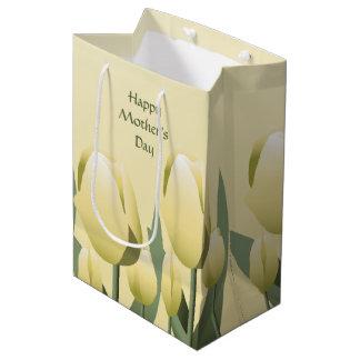Med de tulipes de jaune de ressort de jour de sac cadeau moyen