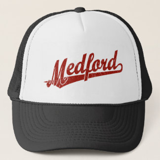 Medford script logo in red distressed trucker hat
