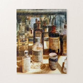 Medicine Bottles in Glass Case Puzzle