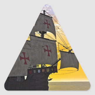 medieval carrack at sunset triangle sticker
