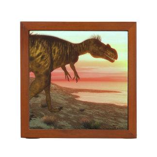 Megalosaurus dinosaur walking toward the ocean desk organizer