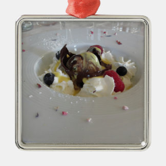 Melted chocolate ball with zabaglione cream metal ornament