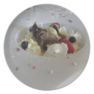 Melted chocolate ball with zabaglione cream party plate
