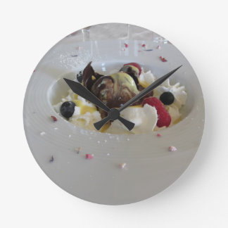 Melted chocolate ball with zabaglione cream round clock