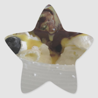 Melted chocolate ball with zabaglione cream star sticker