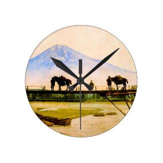 Men and Horses on Bridge Beneath Mt. Fuji Vintage Round Clock