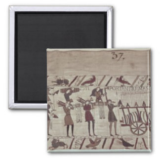 Men carrying arms to the ships and pulling a square magnet