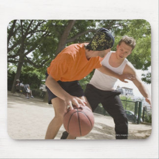 Men playing basketball outdoors mouse pad
