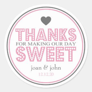 Merci pour faire notre bonbon à jour (rose/gris) sticker rond