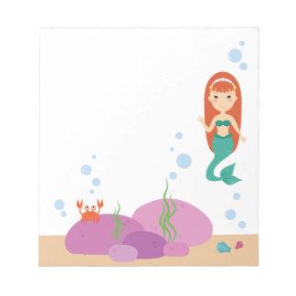 Mermaid cartoon girl swimming in the sea notepad