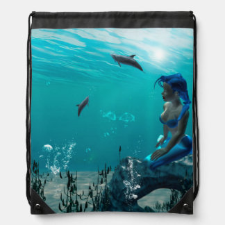 Mermaid sitting on a rock drawstring bag