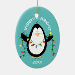 Merry and Bright Christmas Penguin Fun Blue Oval Ceramic Oval Ornament