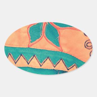 Merry master sample orange turquoise SIRAdesign Oval Sticker