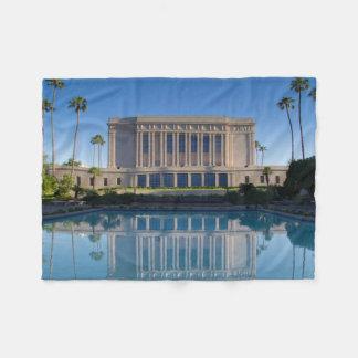 Mesa temple reflecting in a blue pool fleece blanket