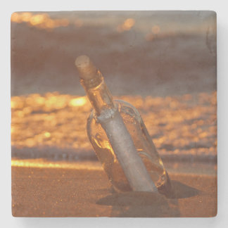 message in bottle on sunset beach stone beverage coaster