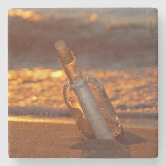 message in bottle on sunset beach stone coaster