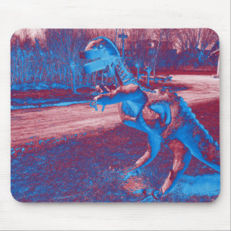 metal dinosaur trex in a park mouse pad