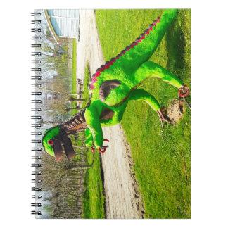 metal dinosaur trex in park photo spiral notebook