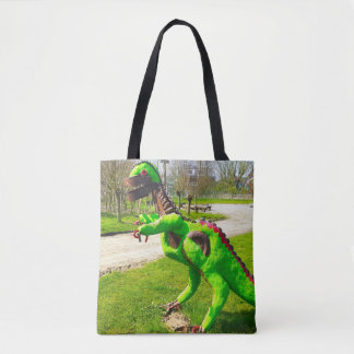 metal dinosaur trex in park photo tote bag