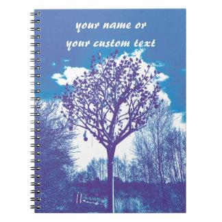 metal tree dull blue notebooks