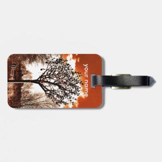 metal tree on the field orange tint luggage tag