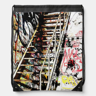 metal urban staircase with graffiti drawstring bag