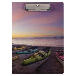 Mexico, Baja, Sea of Cortez. Sea kayaks and Clipboard