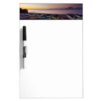 Mexico, Baja, Sea of Cortez. Sea kayaks and Dry Erase Whiteboard