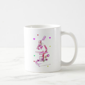 microscope in pink coffee mug