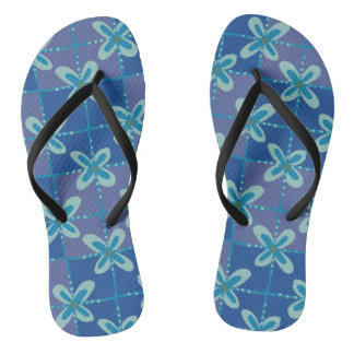 Midnight blue floral batik seamless pattern flip flops