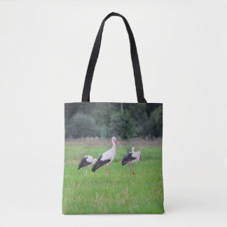 Migrating white storks, ciconia, in a meadow tote bag