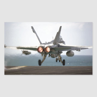 Military aircraft launching off aircraft carrier