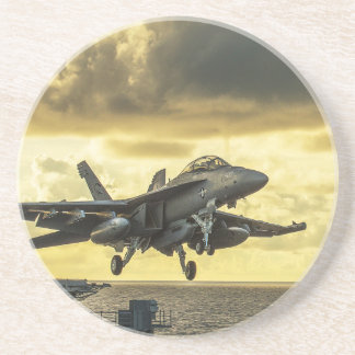 Military aircraft launching off aircraft carrier drink coaster
